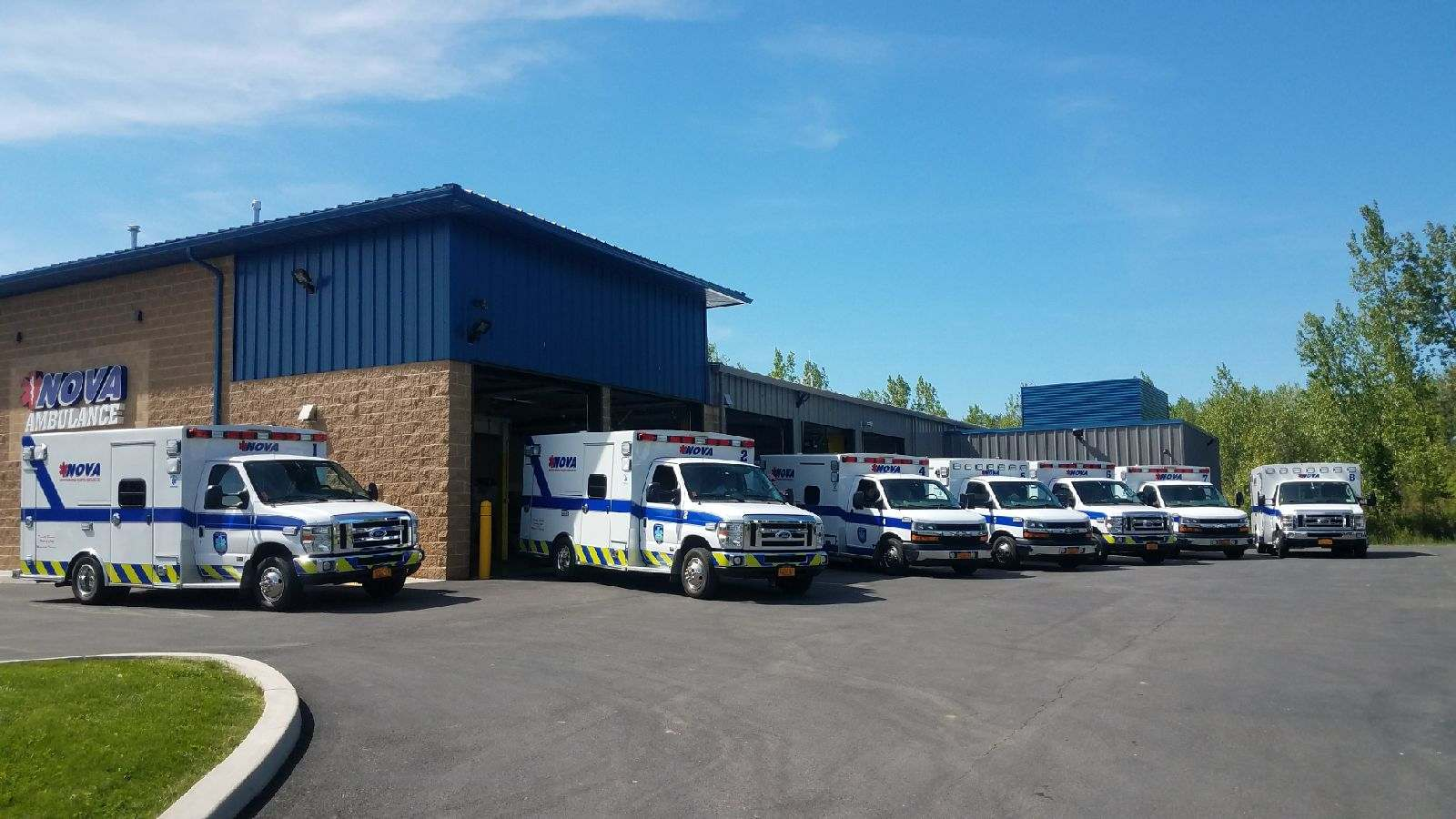 Eight modern ambulances and two squad vehicles.